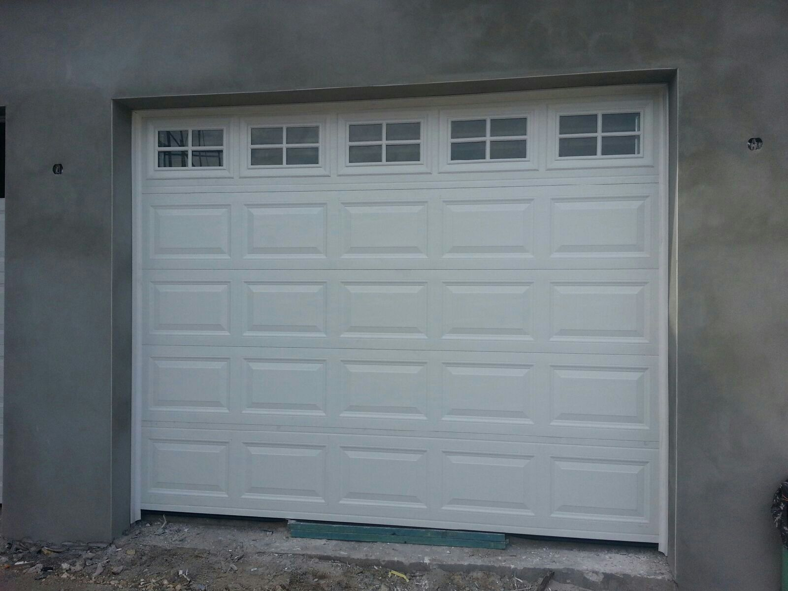 3 panel garage door three panel carriage house garage for Three door garage