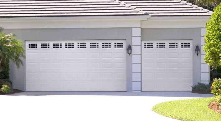 Garage door solutions miami garage doors garage door for 16x7 garage door prices